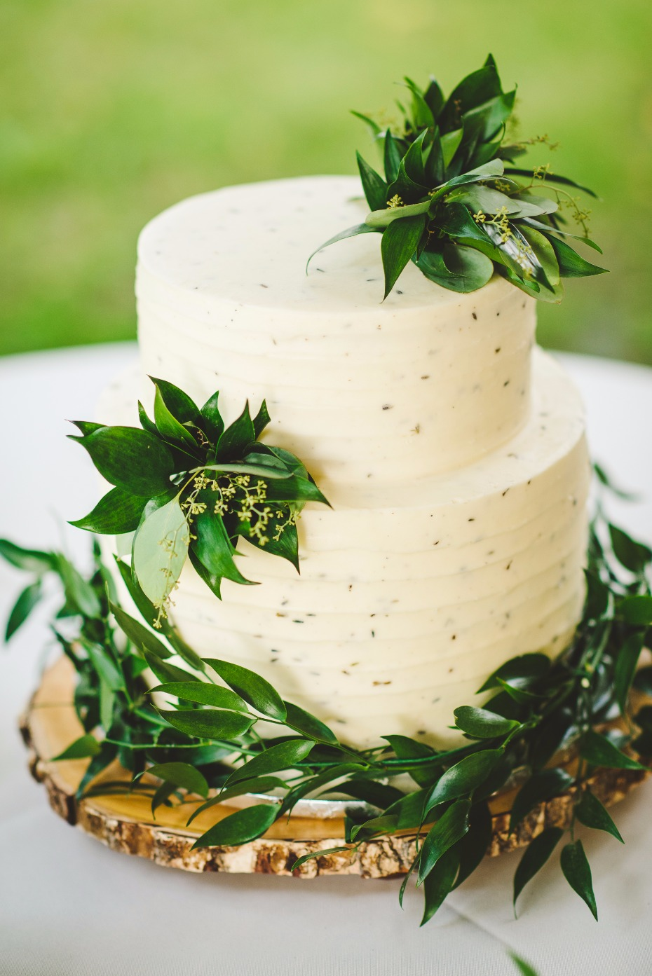 elegant wedding cake with simple greenery accents