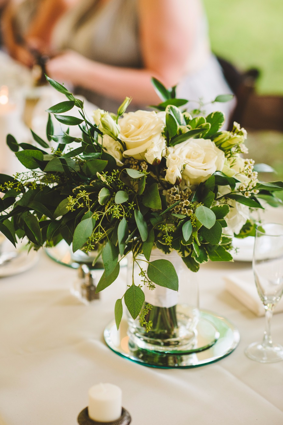 white rose and greenery centerpiece