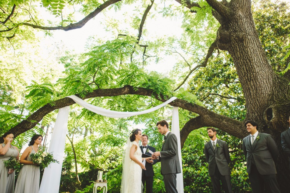 garden wedding ceremony with simple white sash decor
