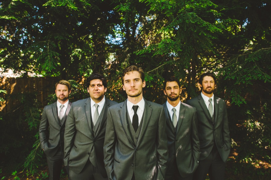 groom in charcoal grey suit and groomsmen in matching suits