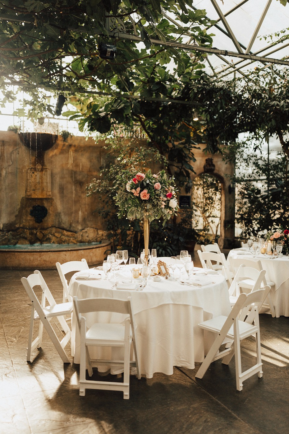 glammed up summer boho wedding reception in the garden room at La Caille
