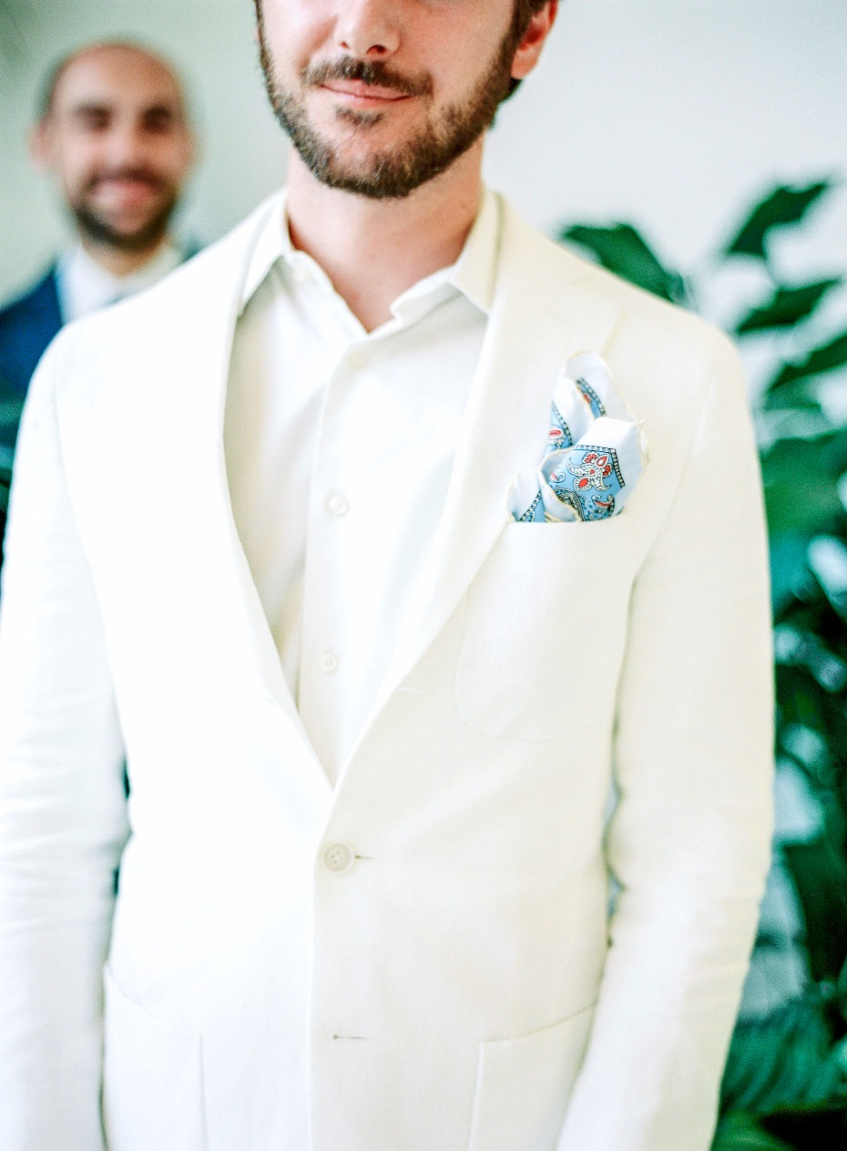 All white with a colorful handkerchief