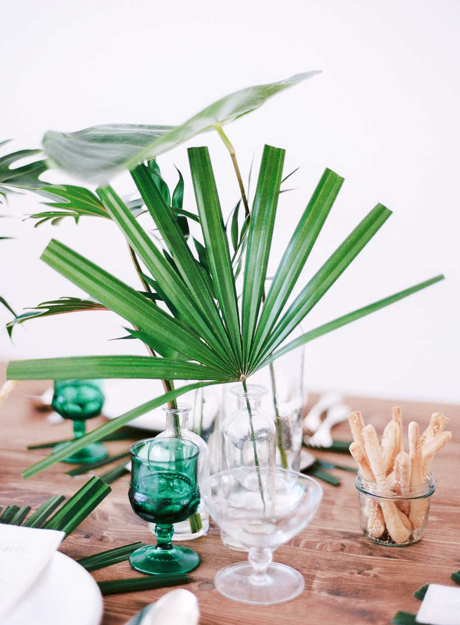 Palm leaves in clear vases