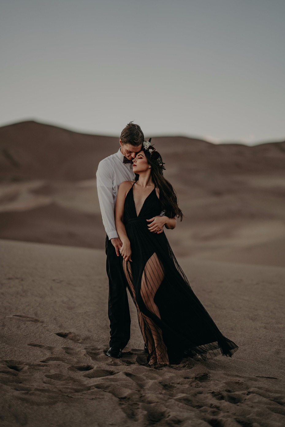 black dress engagement shoot outfit