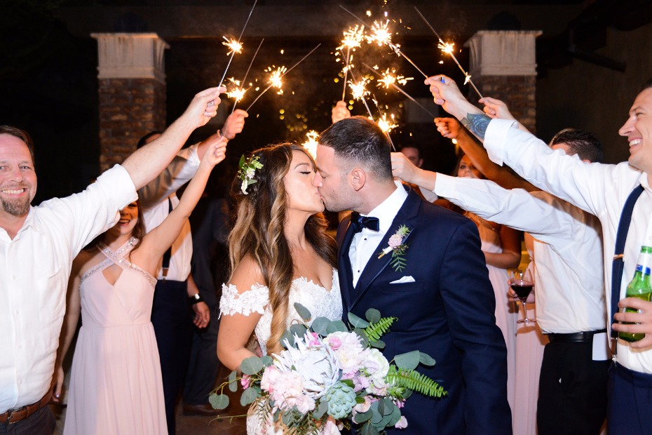 wedding kiss and sparkler exit