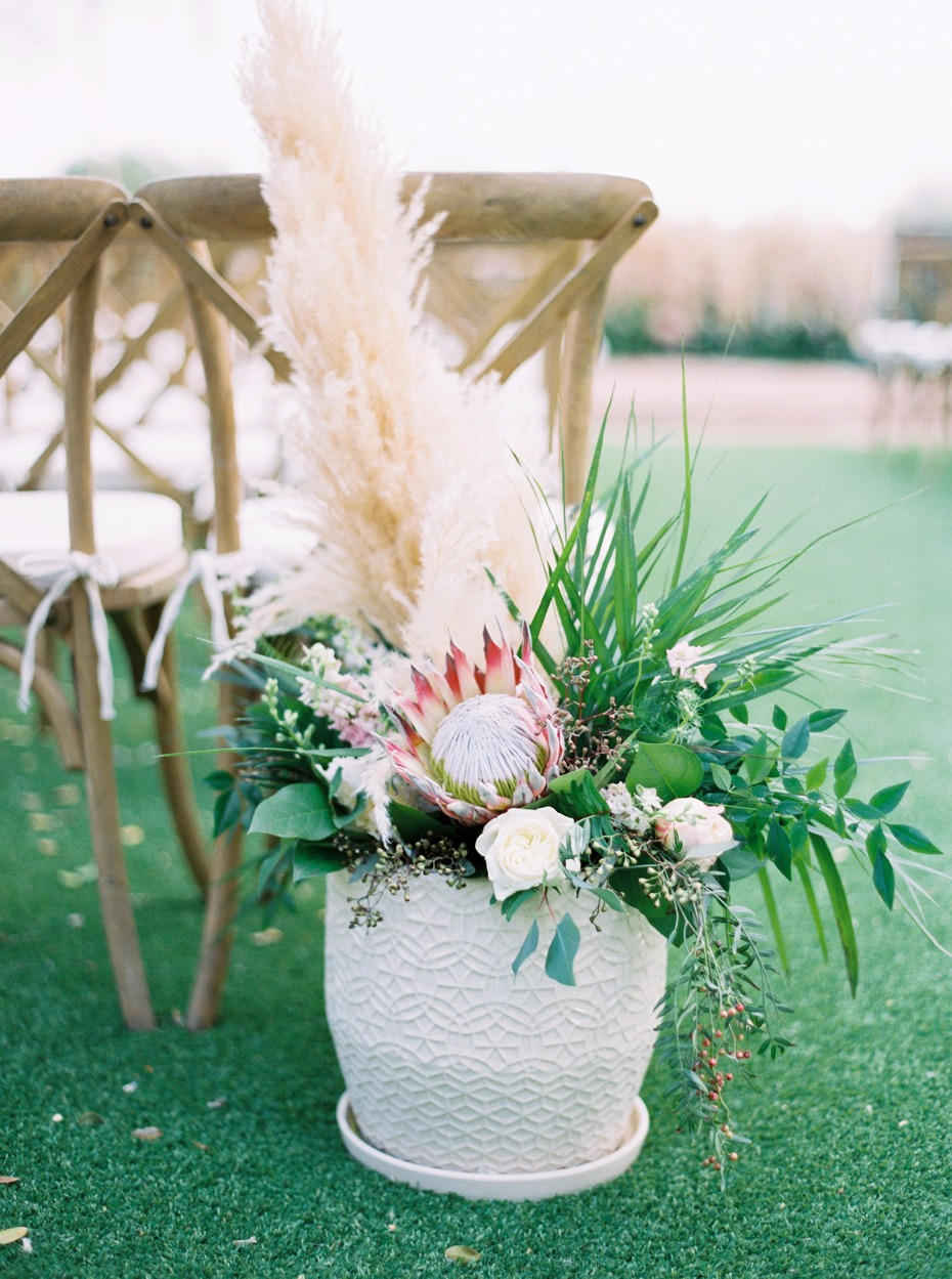 tropical meets desert wedding floral arrangement