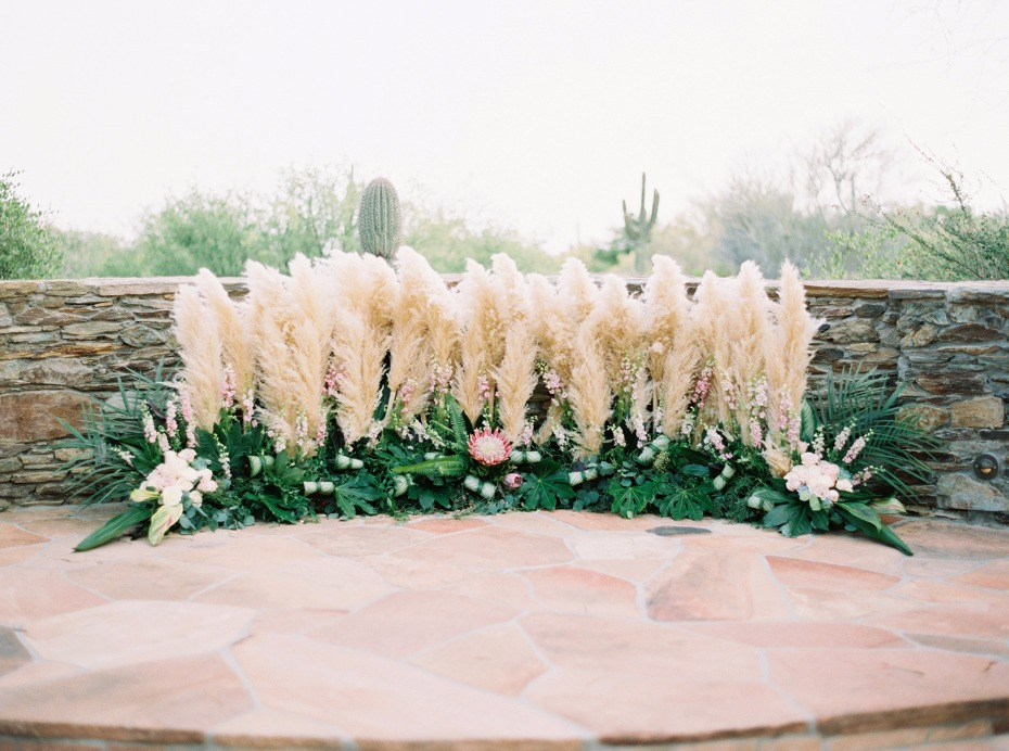 desert grasses and tropical floral wedding backdrop