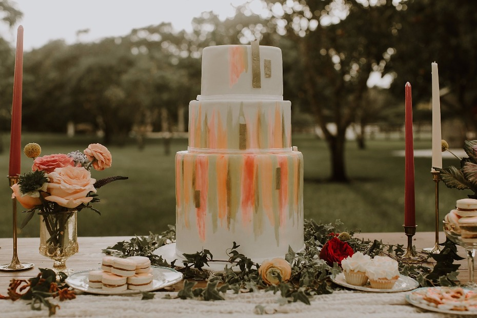"Peach and gold ""painted"" wedding cake"