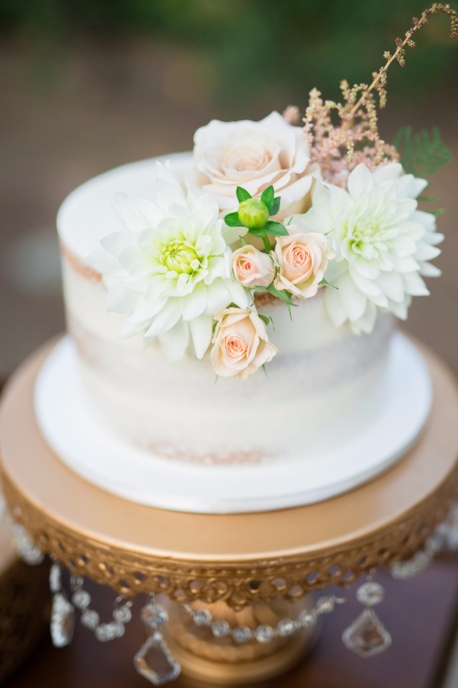 Naked cake with floral topper