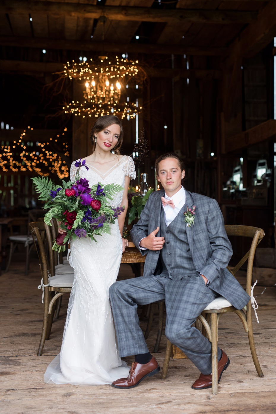 groom in unique plaid suit and bride in a slinky vintage inspired gown