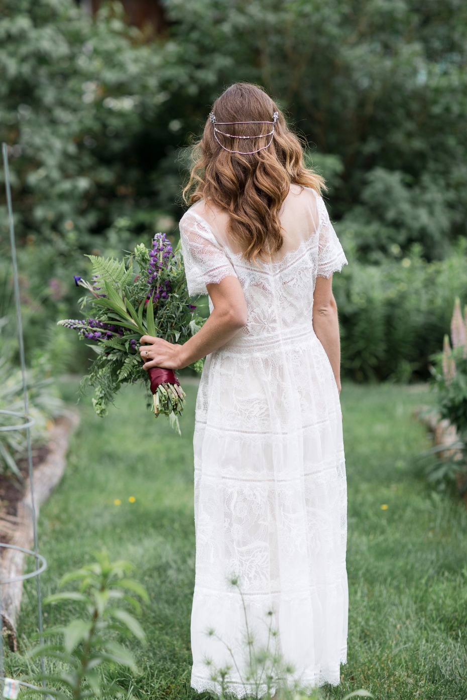 boho chic bridal style with hair chains and foraged wedding flowers