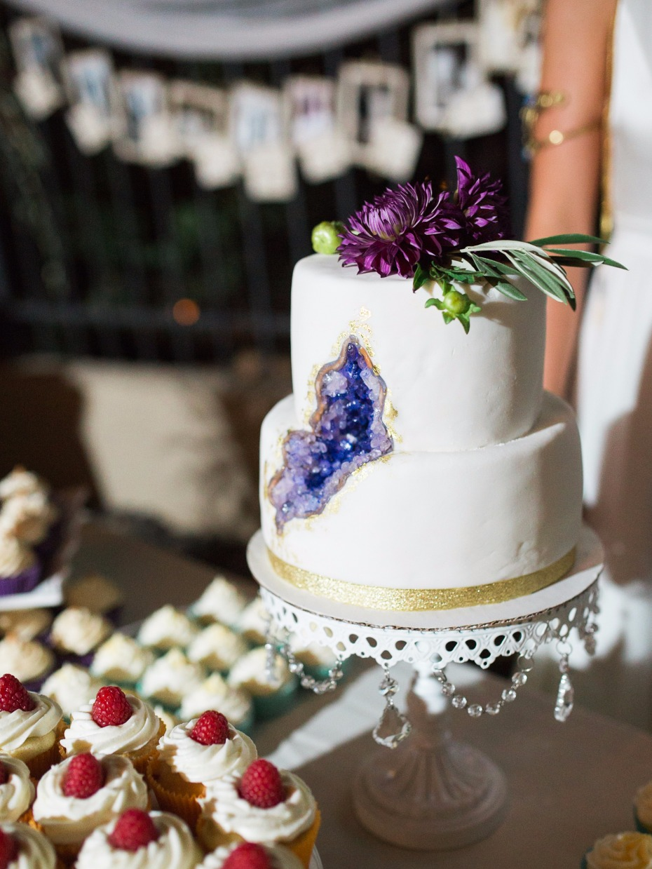 geode wedding cake with purple floral topper