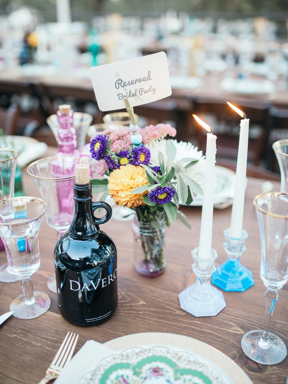 bride and grooms favorite wine mixed with mismatched table accessories