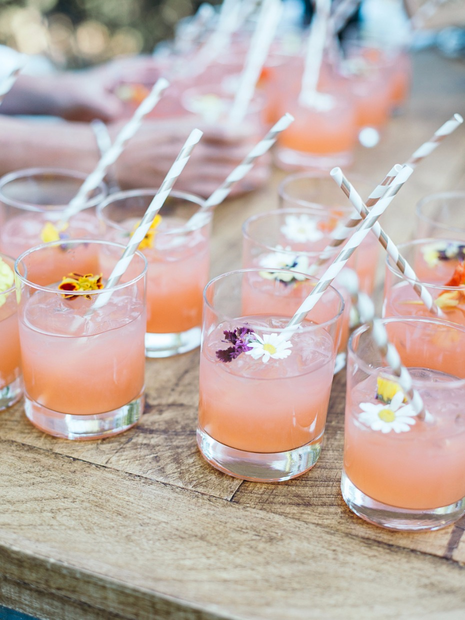 pink wedding cocktails with edible floral garnish