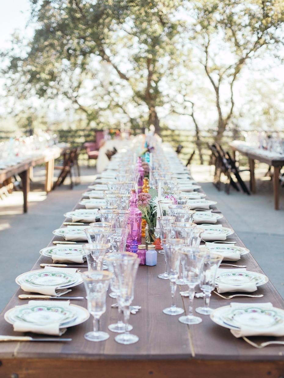 fun family style wedding tables with boho shabby chic style place settings