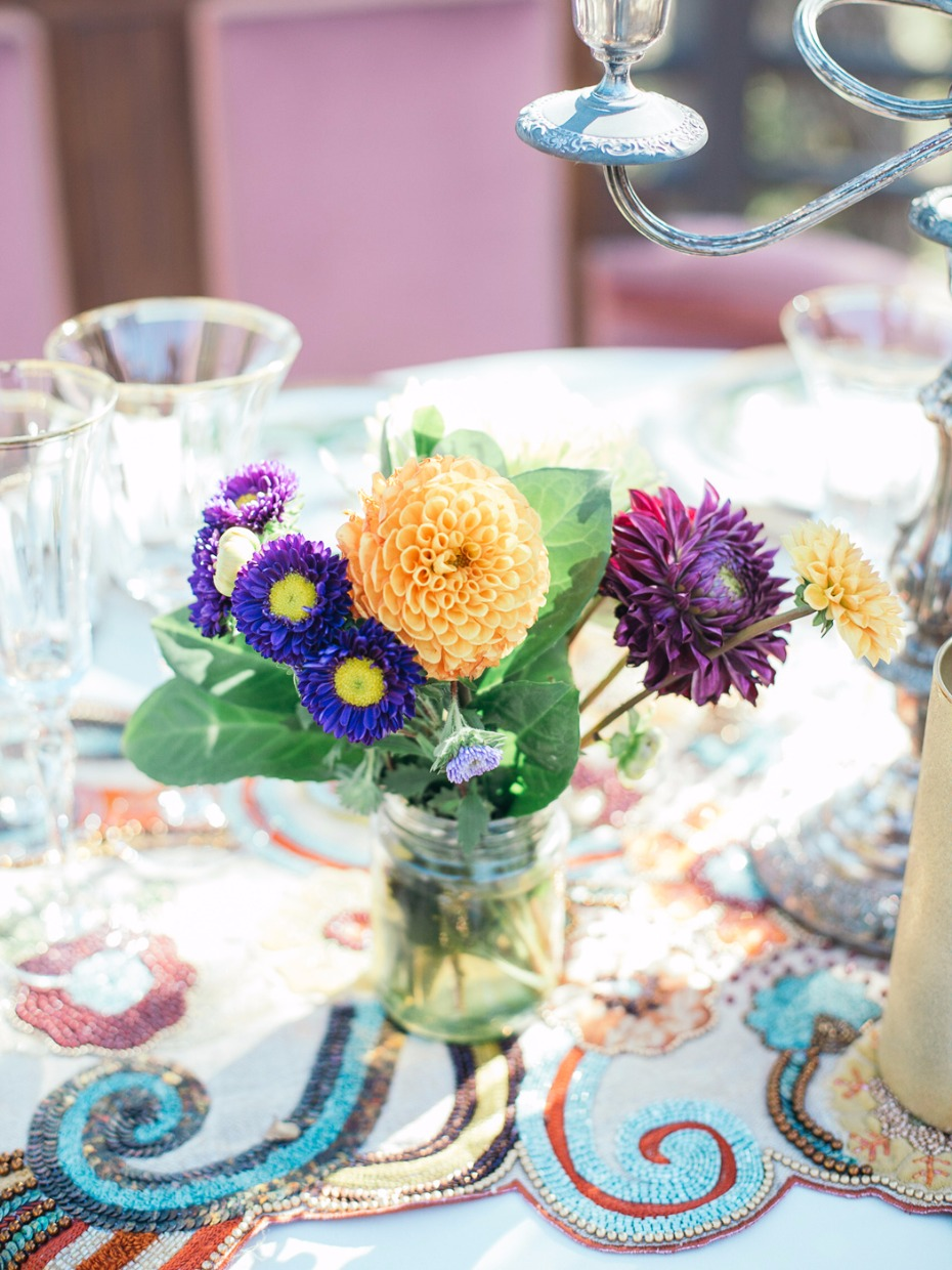 bright and fun wedding flowers in a mason jar for your sweetheart table