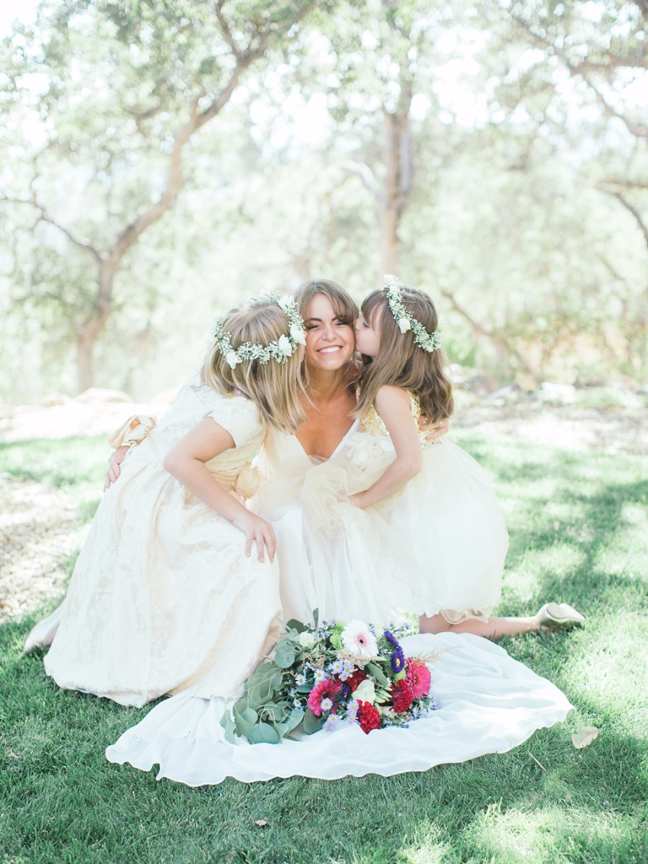 cute flower girl and bride wedding photo pose
