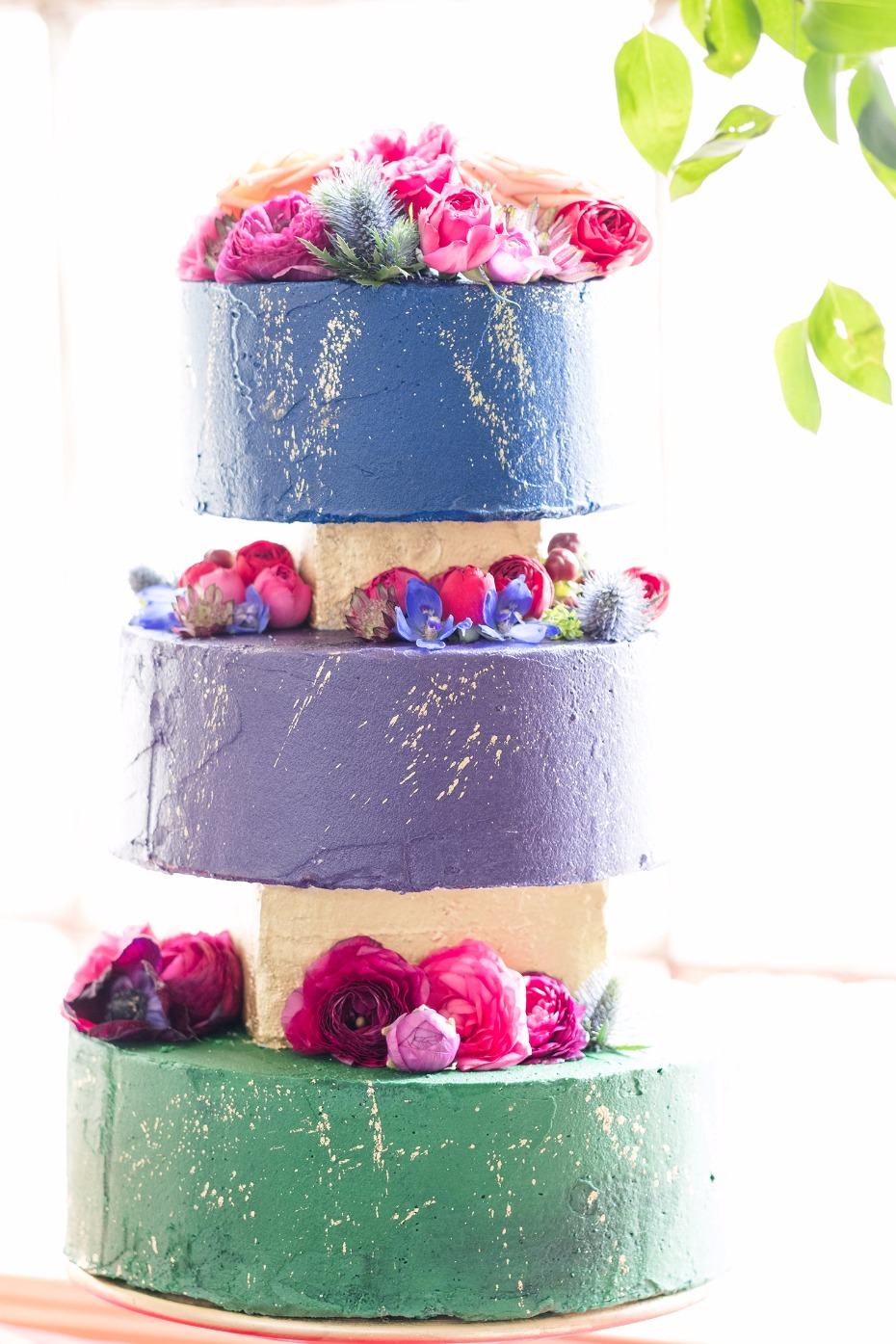 gold flecked jewel tone wedding cake with a modern flair