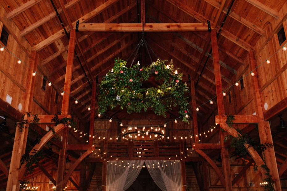 impressive floral accented chandelier at this rustic barn venue