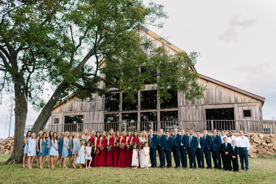 an impressive wedding party for this rustic texas wedding