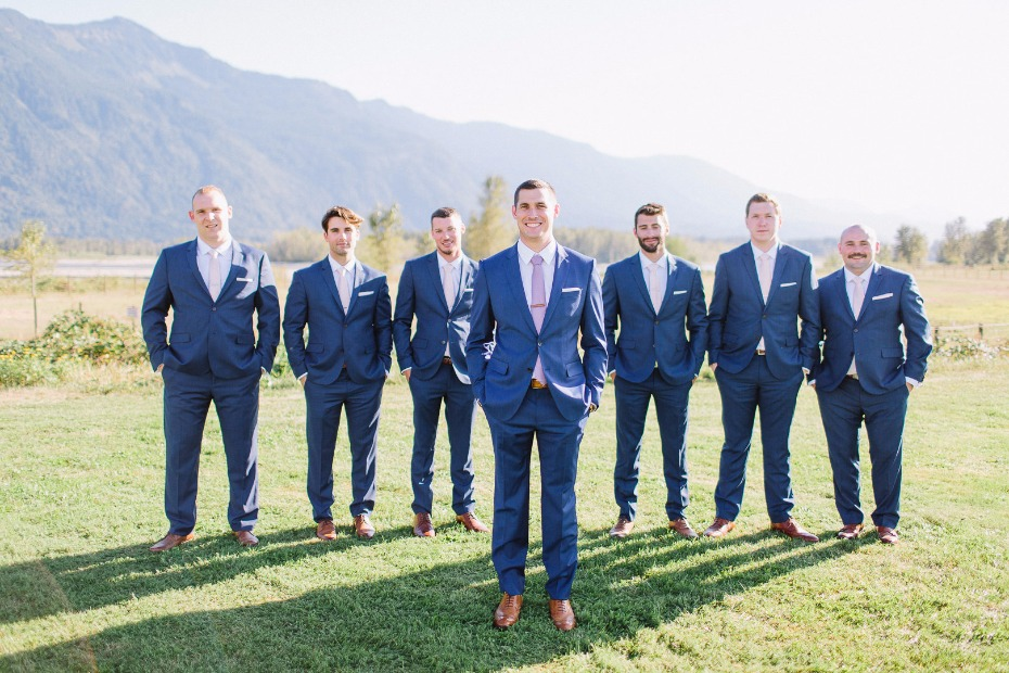 Groom in navy suits with blush ties