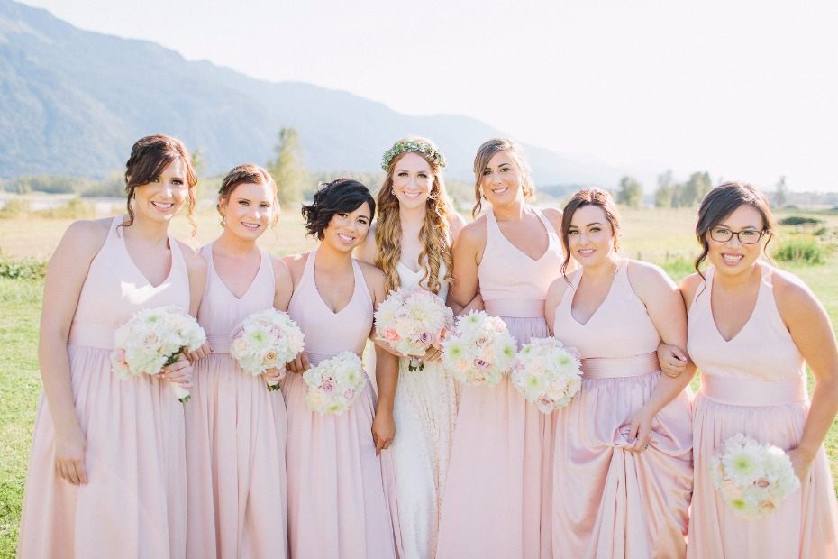 Blush bridesmaid dresses and white bouquets