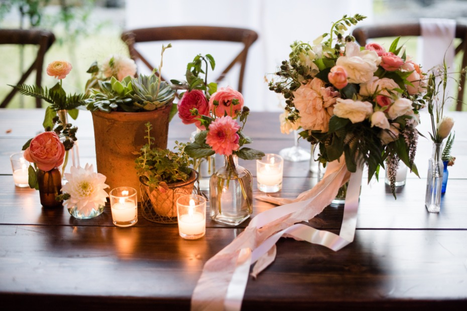 glowing wedding centerpieces with sweet bud vases and live potted plants
