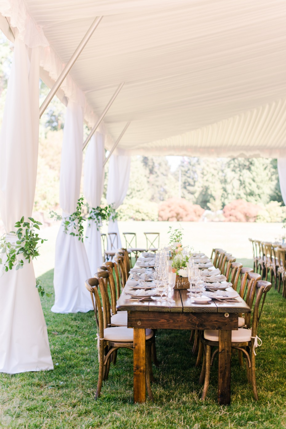 white tent wedding reception with family style seating