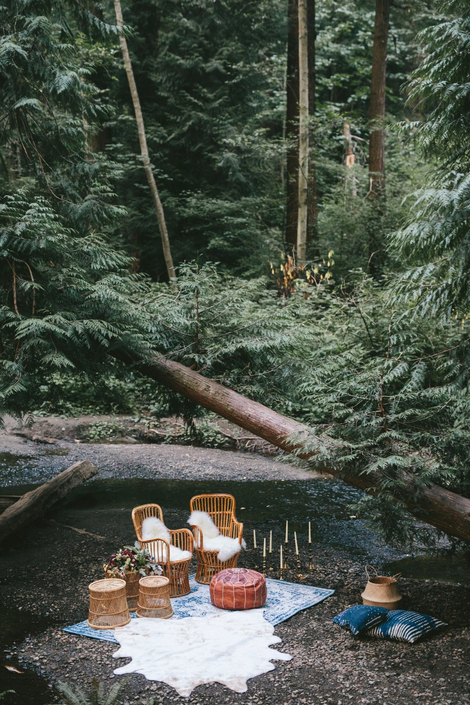 whimsical wedding lounge by a wooded stream