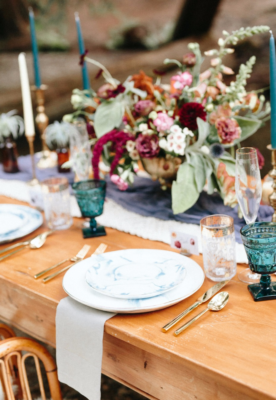 mismatched wedding table decor give the table a shabby chic quality