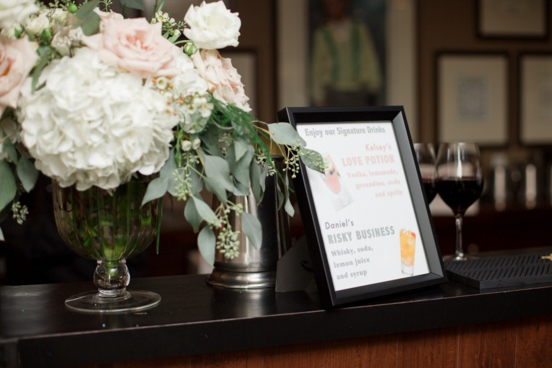 Pretty flowers beside your signature drink signage! Florals by Dandie Andie Floral Designs   Photo by Daniel Ricci