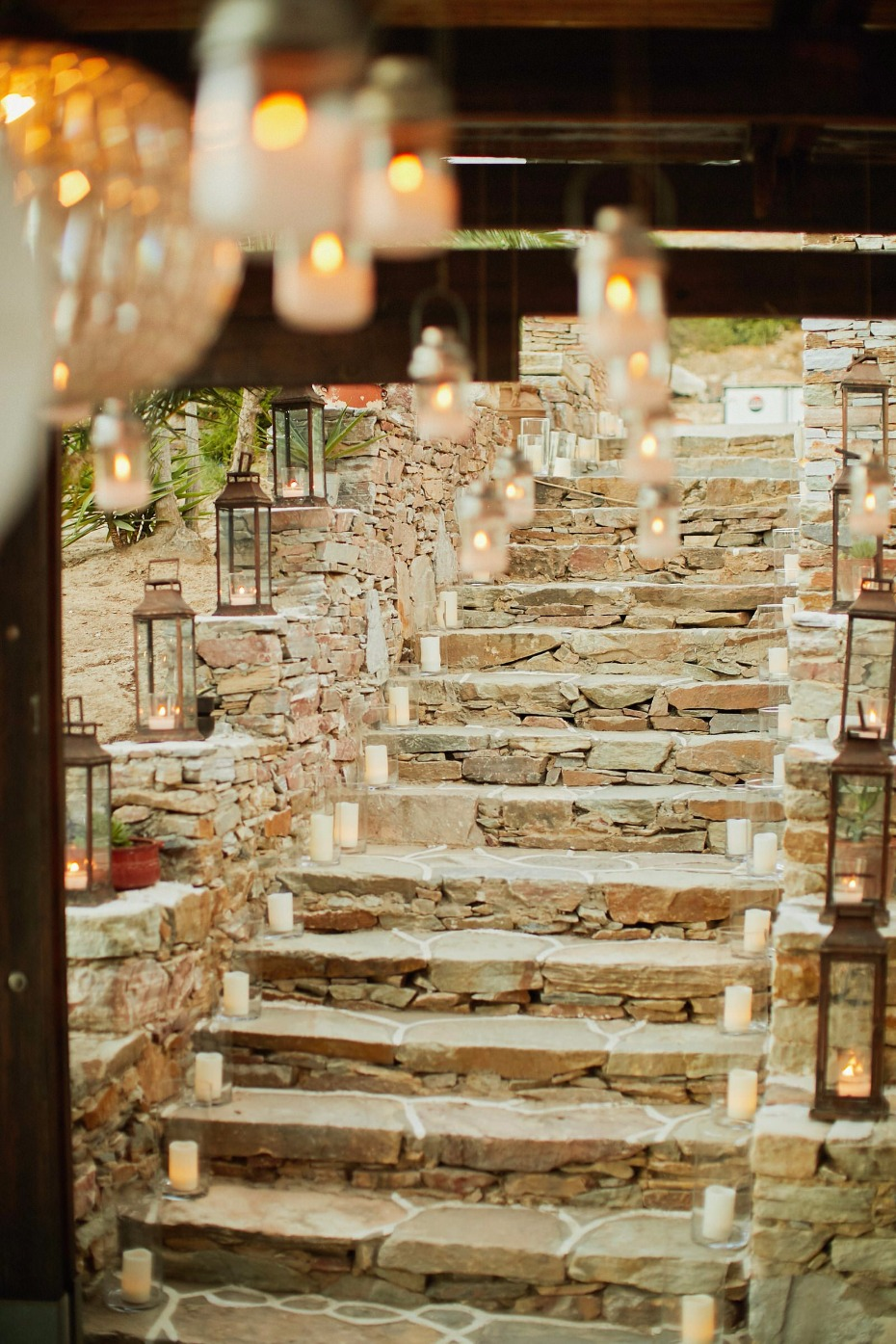 candle lit stairway entry into this Greek island wedding reception