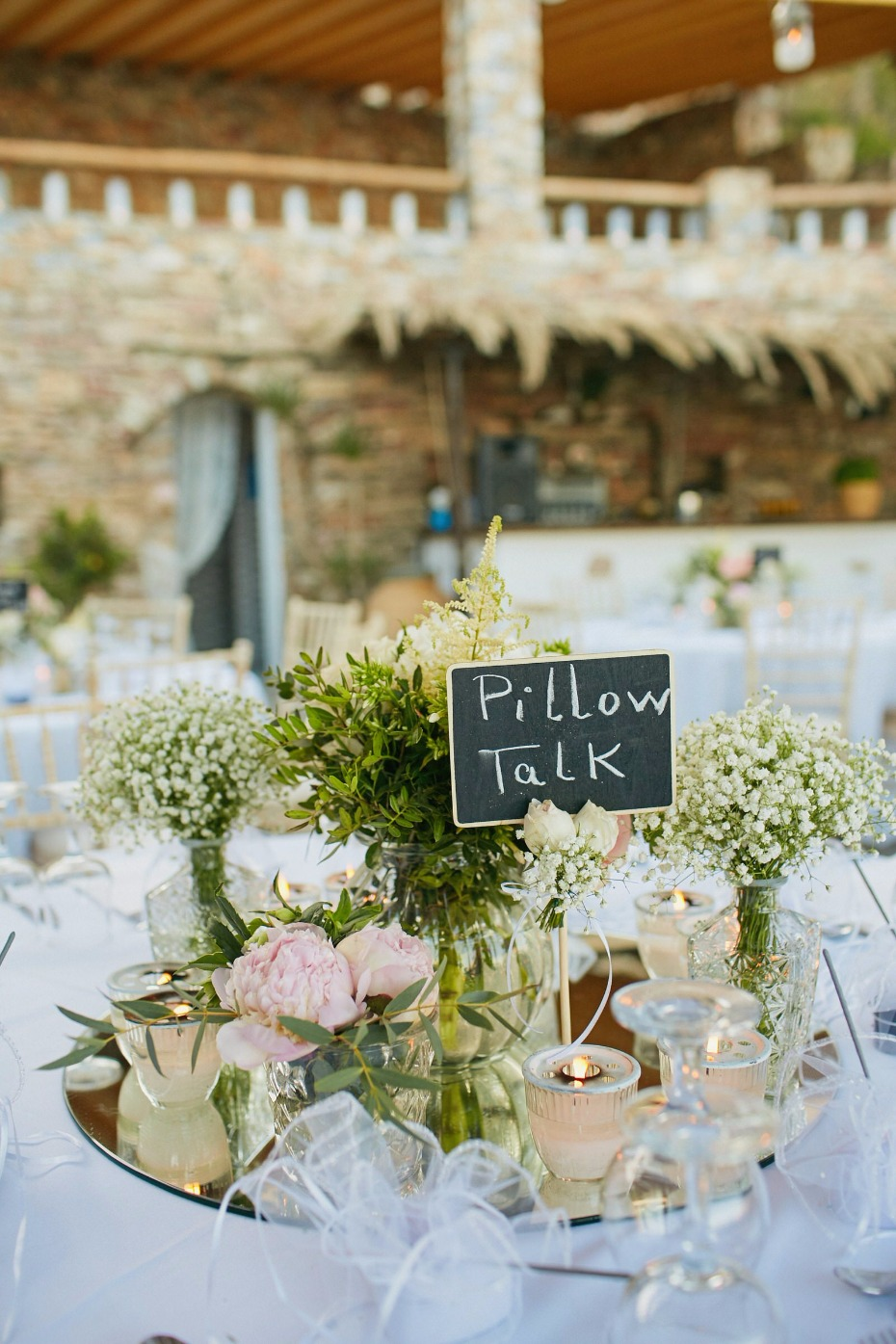 pillow talk wedding table name and whimsial centerpiece