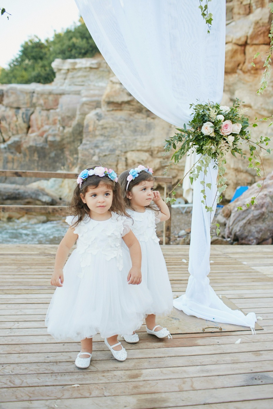 sweet flower girls all set for the walk down the aisle