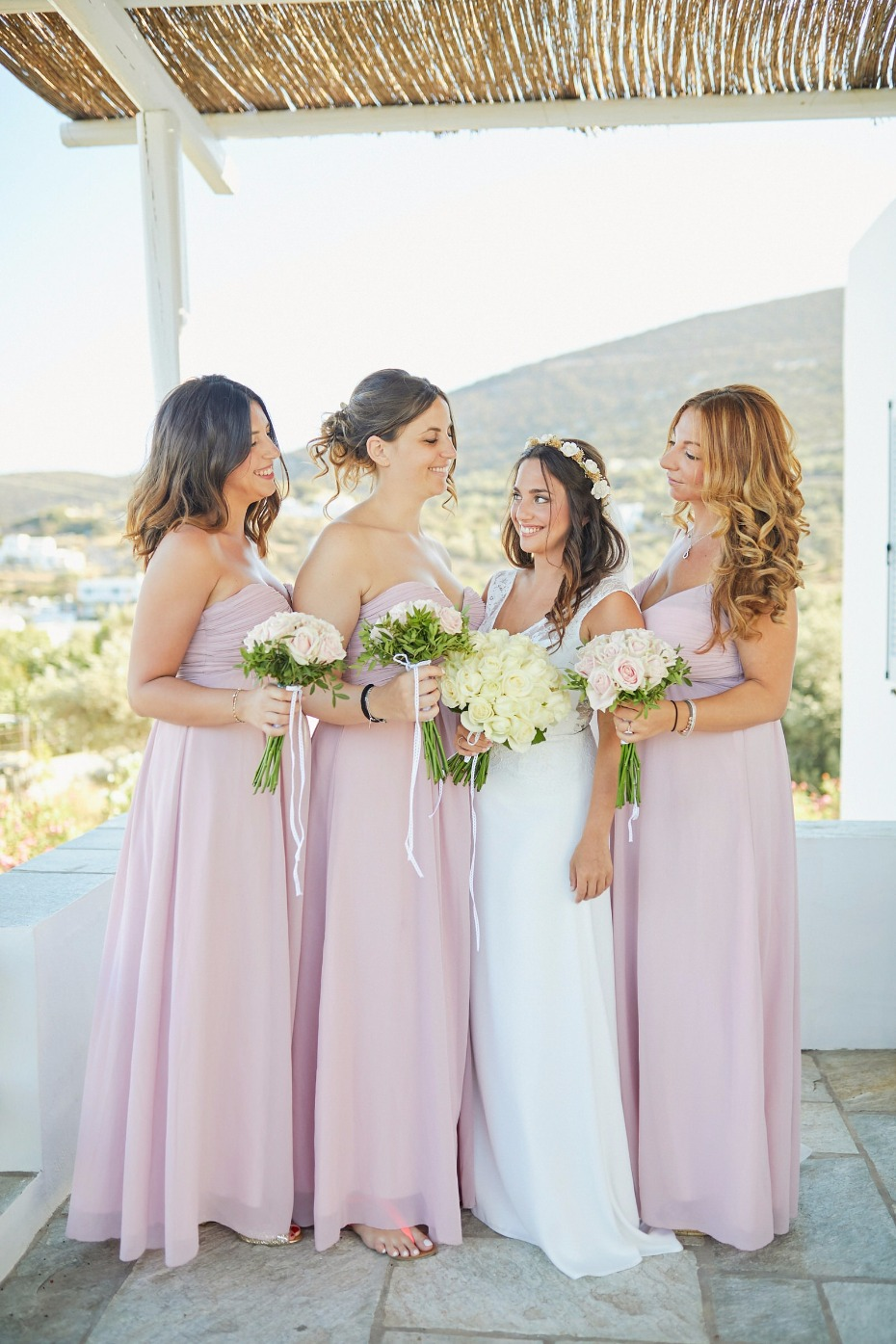 blushing bridesmaids in soft blush dresses