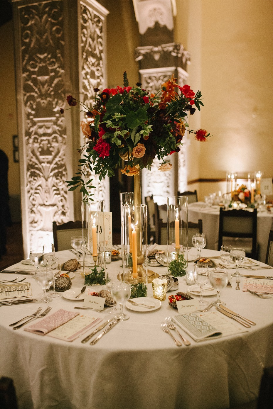 Tall floral centerpiece with candles