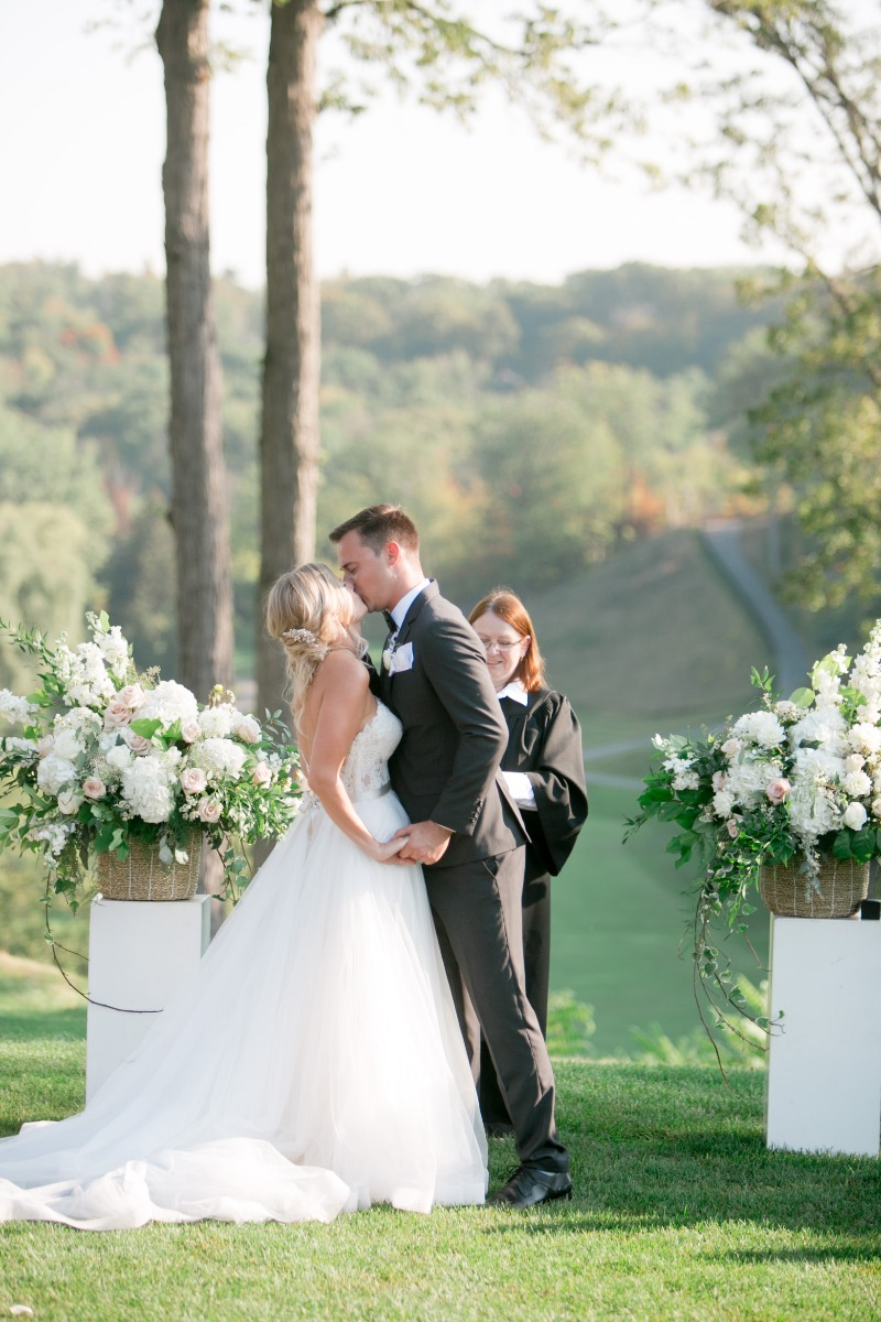 First Kiss as Husband and Wife! Florals by Dandie Andie Floral Designs | Photo by Daniel Ricci