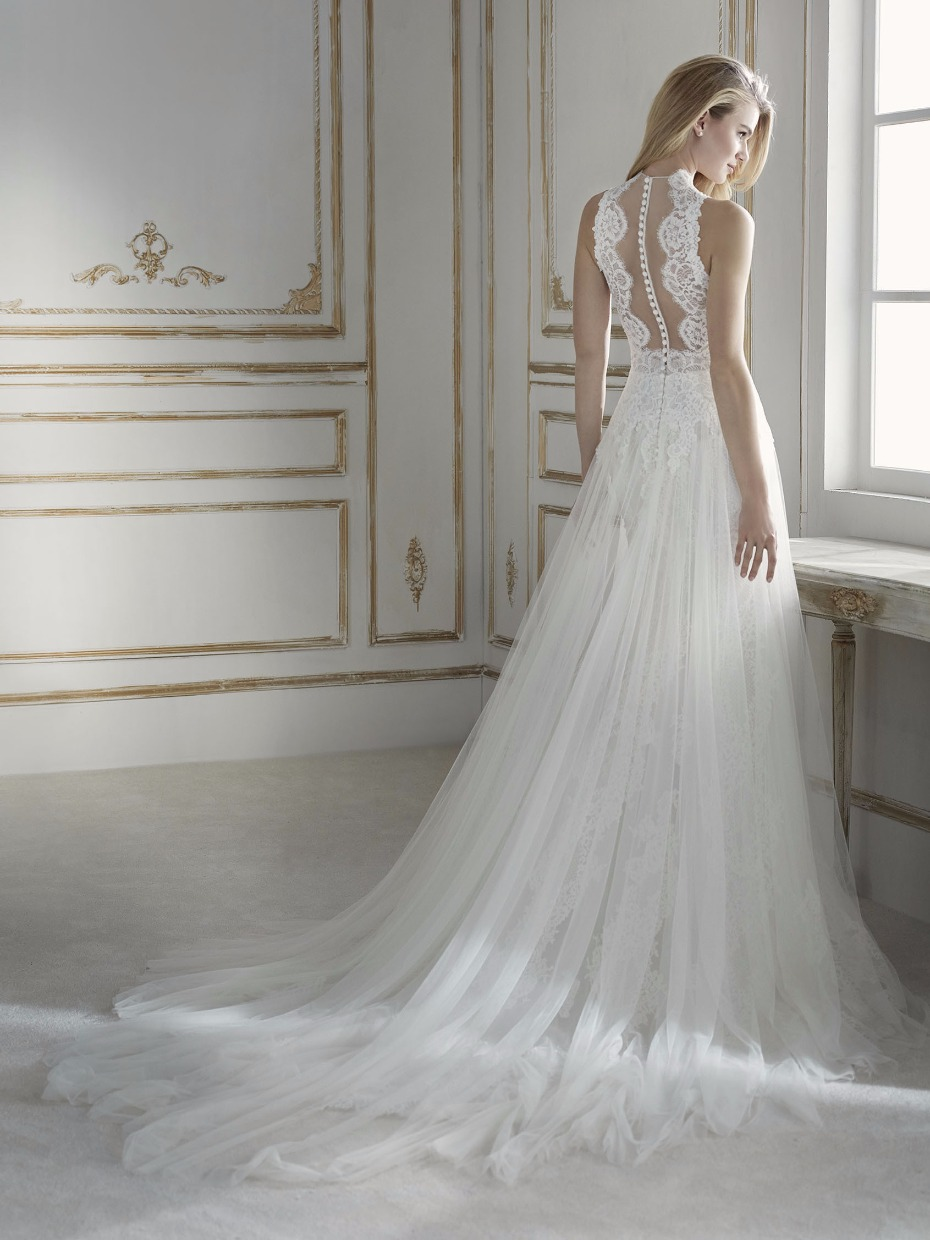 high neckline and back are decorated with illusions