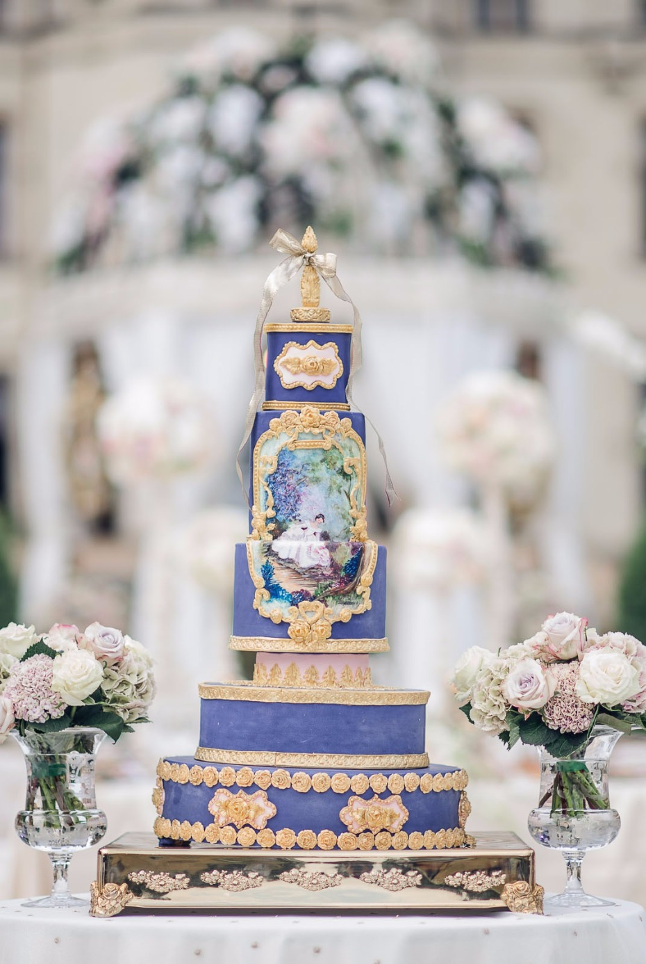 storybook fantasy wedding cake in purple and gold