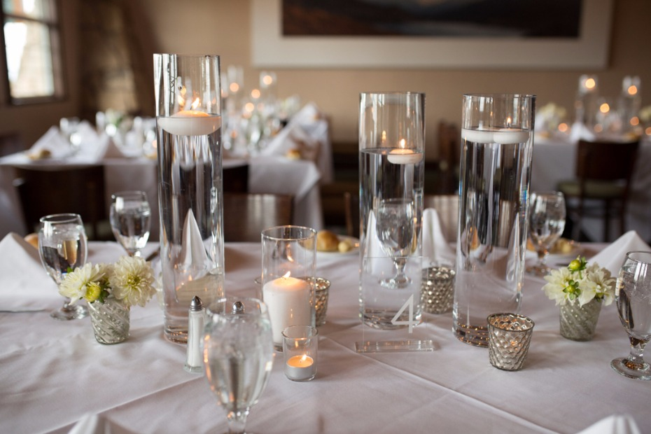 all white and wedding table centerpiece and floating candles