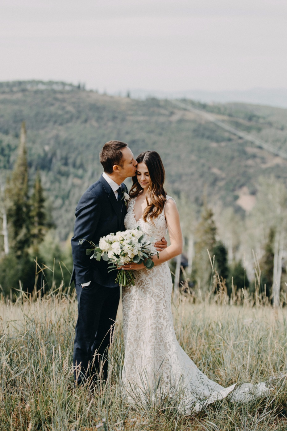 bride and groom on a mountain top in Utah
