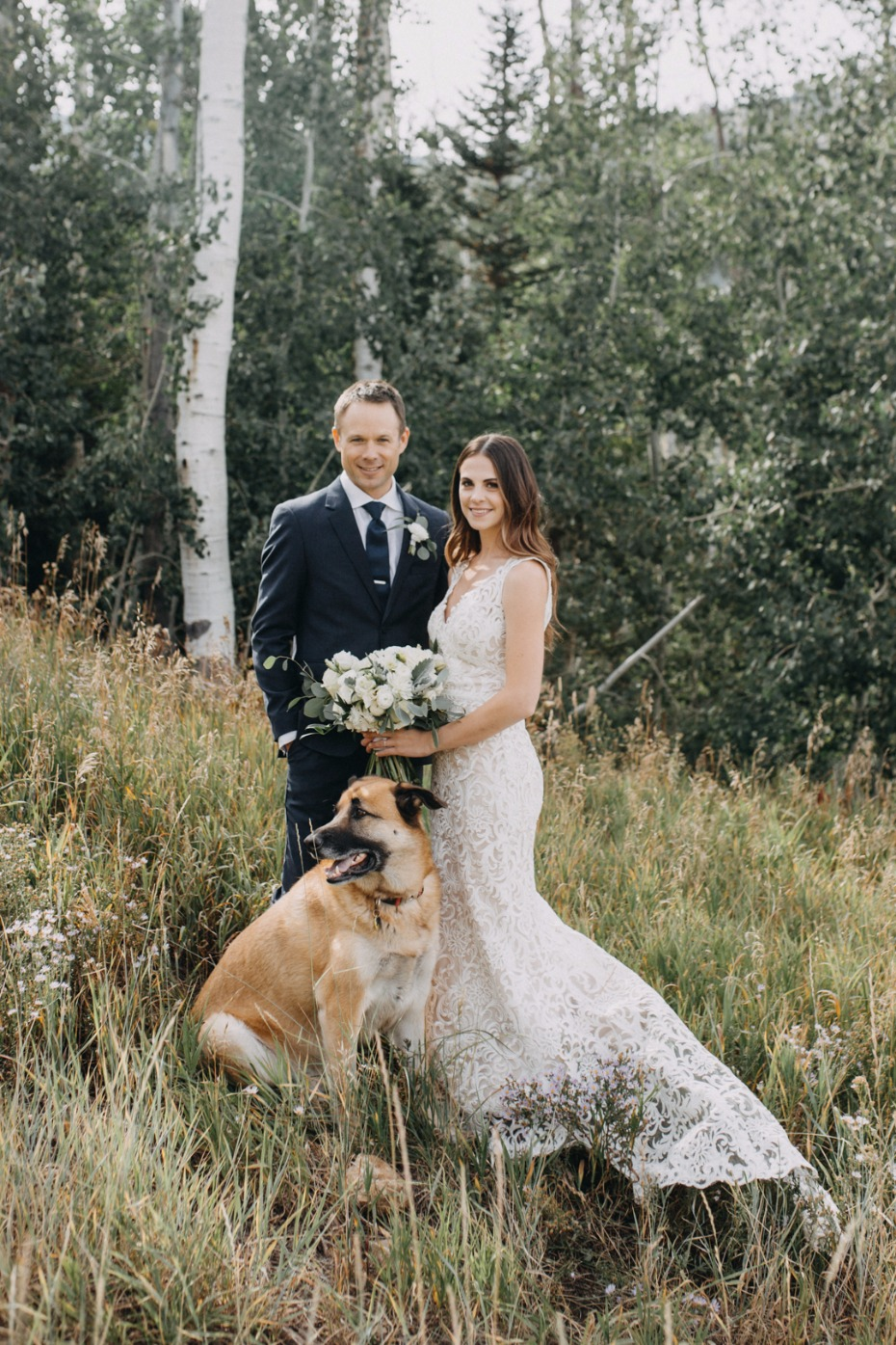 rustic mountain top wedding couple with their dog