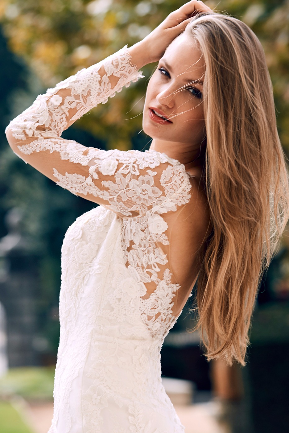 natural wedding look in a long sleeve lace mermaid wedding gown
