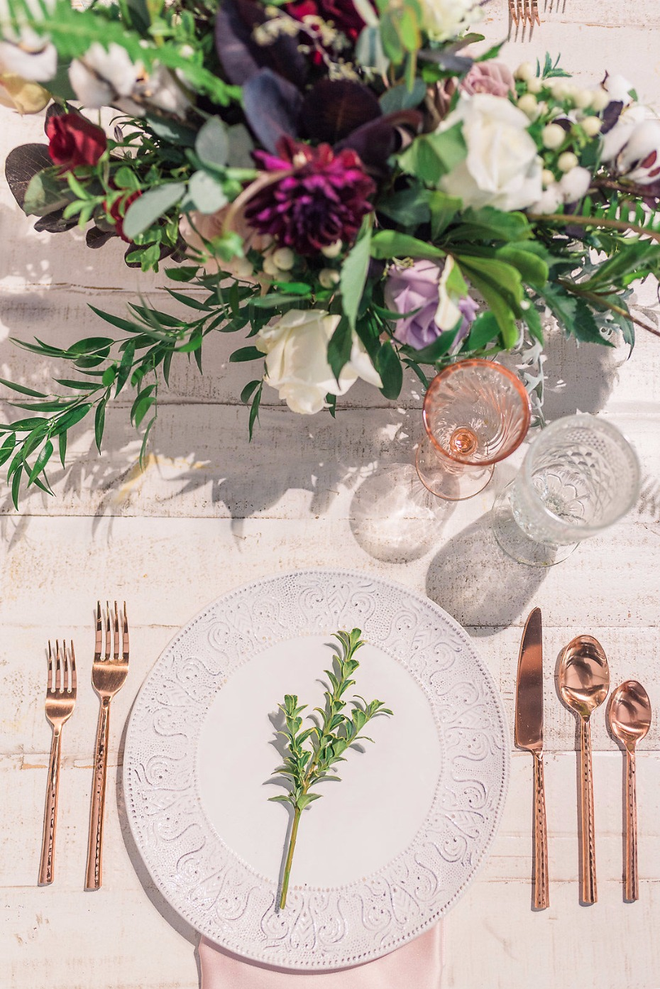 Simple place setting with rose gold flatware