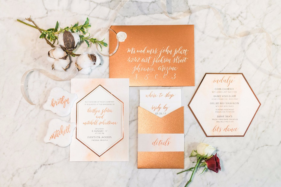Geometric gold invitation suite