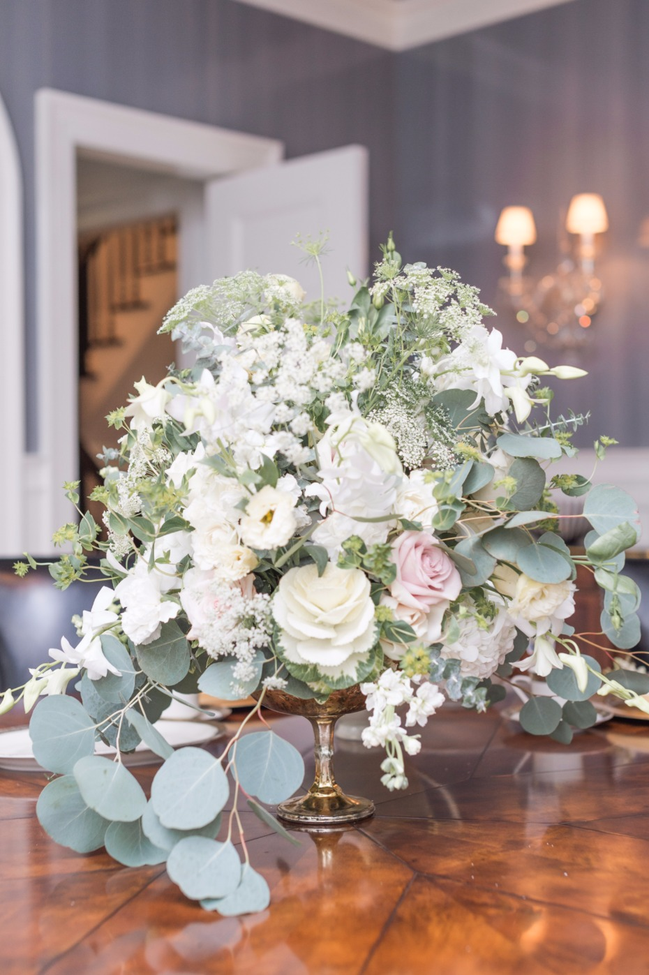 cascading wedding centerpiece in neutral florals and greenery