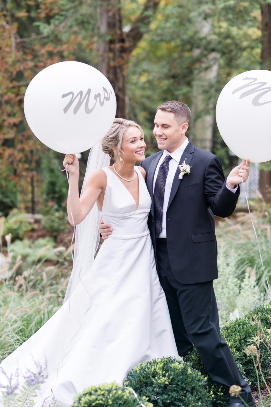 very cute bride and groom photo with mr and mrs giant balloons