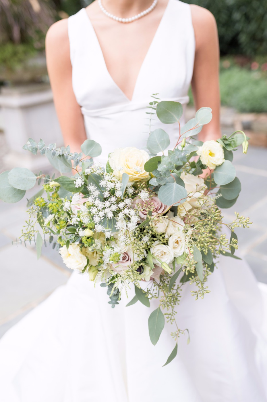 neutrals wedding bouquet with varying whites and greenery