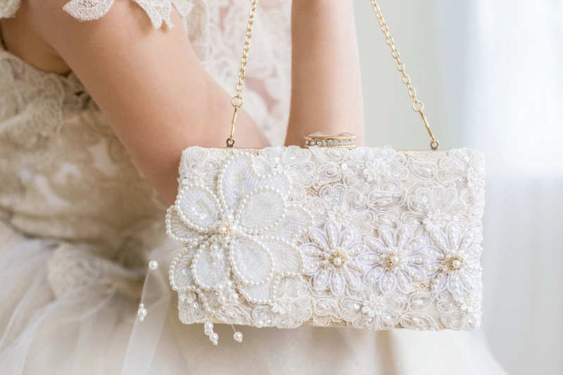 Ivory beaded pearls with a touch of a beaded flower make this a stunning statement clutch.