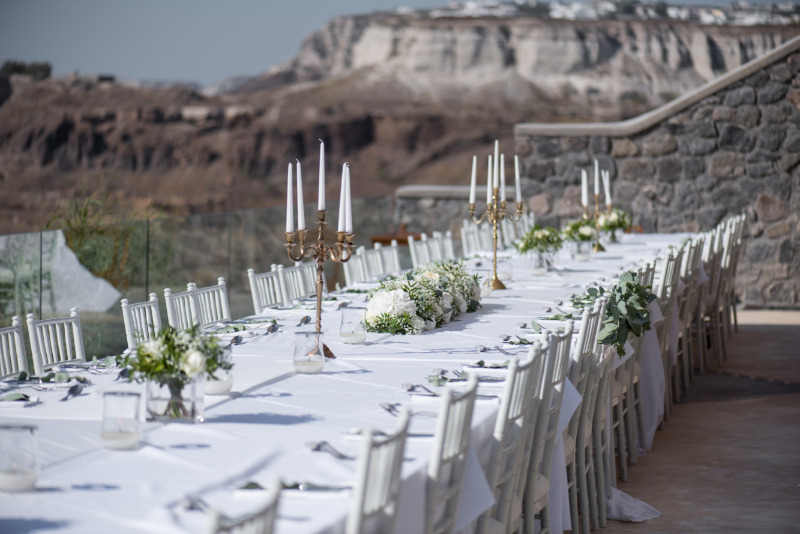 Wedding reception with view! Photo from real destination wedding in Santorini. See more